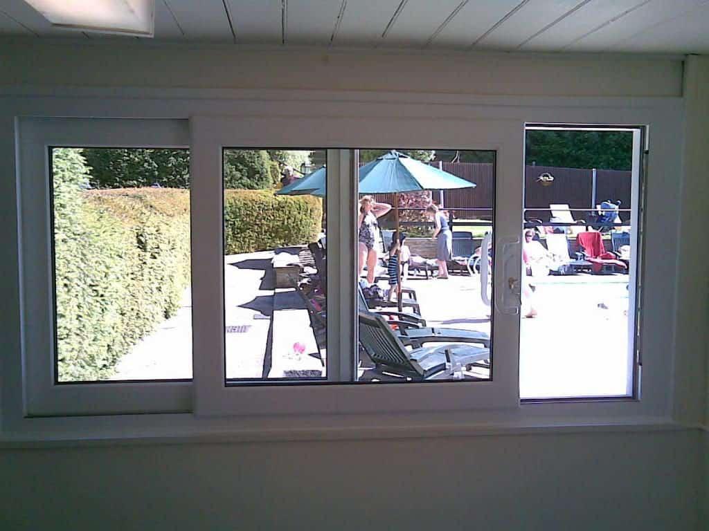 White uPVC sliding patio door used as window of swimming pool reception