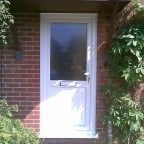 White uPVC front door with white furniture