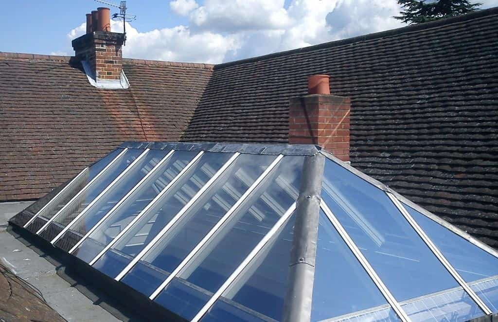 Timber lantern roof lights with aluminium top caps and clear glass by Dorking Glass