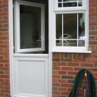 White uPVC half stable door and side window with Georgian Bars