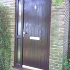 Rosewood GRP Composite front door with a Rosewood uPVC outerframe, sidelight and gold colour furniture