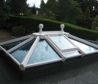 White uPVC lantern rooflight with clear glass and ball finial