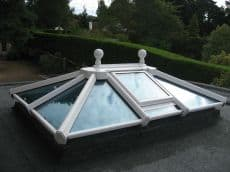White uPVC lantern roof lights with clear glass and ball finial
