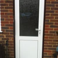 White uPVC back door with obscure glass