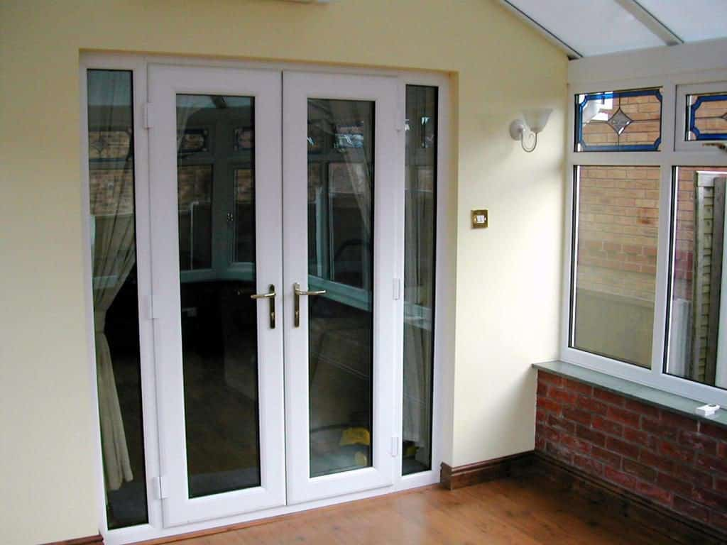 White uPVC French Doors with two full length side windows