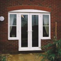 White uPVC French Doors with two side windows