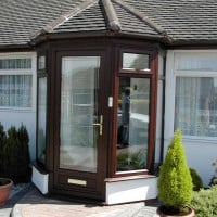 Rosewood uPVC porch with gold furniture
