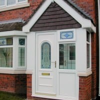 White uPVC porch with decorative front door glass