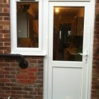 White uPVC back door with side window