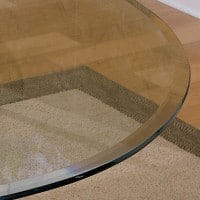 Glass table top with bevelled edges
