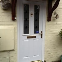 White GRP composite door with Gold colour furniture