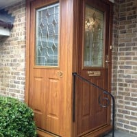 Golden Oak GRP Composite front door with matching colour outerframe and gold colour furniture