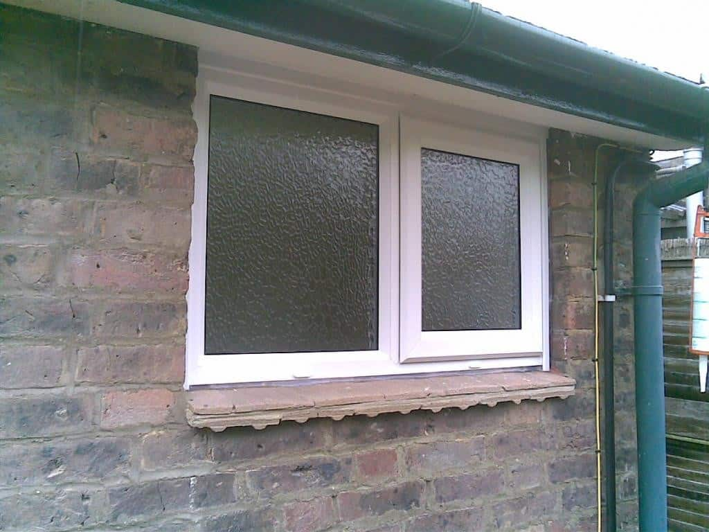 White uPVC window with obscure glass