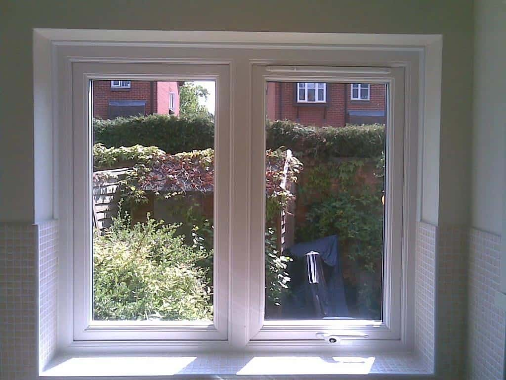 White uPVC window with a dummy casement for equal sight lines and a 4000 trickle vent in the opening casement