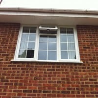 White uPVC window with 18mm white internal Georgian Bars