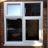 White uPVC window with chamfered framing and a 4000 trickle vent in the fanlight
