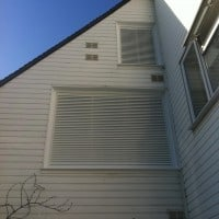 White uPVC windows with white powder coated aluminium fixed louvres