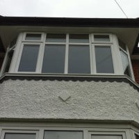 White uPVC bay window with chamfered framing