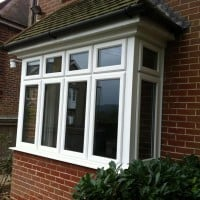 White uPVC window with chamfered framing and dummy casements for equal sight lines