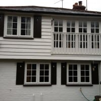 A-rated White uPVC windows with fully sculptured framing, surface mounted Georgian Bars and black antique style monkeytail handles