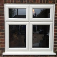 White woodgrain A-rated uPVC window. Liniar fully sculptured framing with dummy casements for equal sight lines