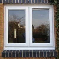 White uPVC window with fully sculptured framing and a dummy casement for equal sight line. 4000 trickle vent in casement.