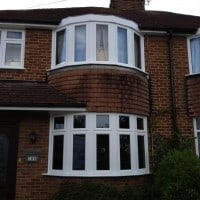 Externally glazed white uPVC Swiftframe profile chamfered framing windows with dummy casements for equal sight lines