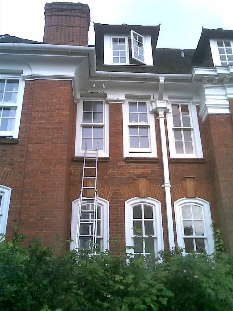 uPVC vertical sliding window with surface mounted Georgian Bars