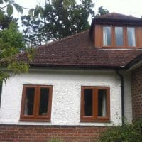 Light Oak uPVC windows with chamfered framing and dummy casements for equal sight lines