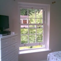 uPVC vertical sliding window with surface mounted Georgian Bars
