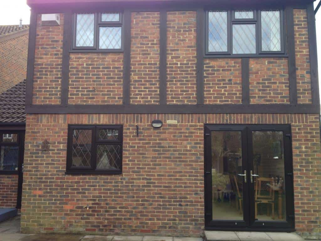 Brown black upvc windows gallery dorking glass for Upvc company