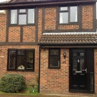 Brown Black A-rated uPVC windows with 9mm diamond leaded lights