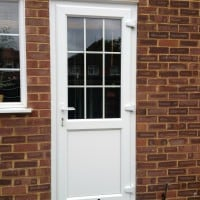 White Liniar profile uPVC back door – bevelled beading and framing.  18mm internal Georgian bars with clear glass