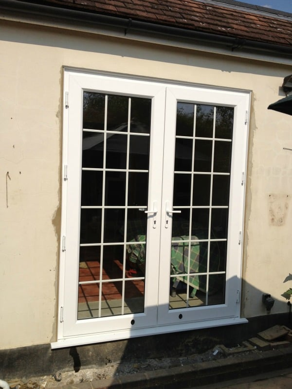 White Swiftframe uPVC. Bevelled framing and beading. Internal 18mm white Georgian bars and white handles.