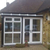 White uPVC entrance porch/conservatory with black uPVC trims to imitate original timber