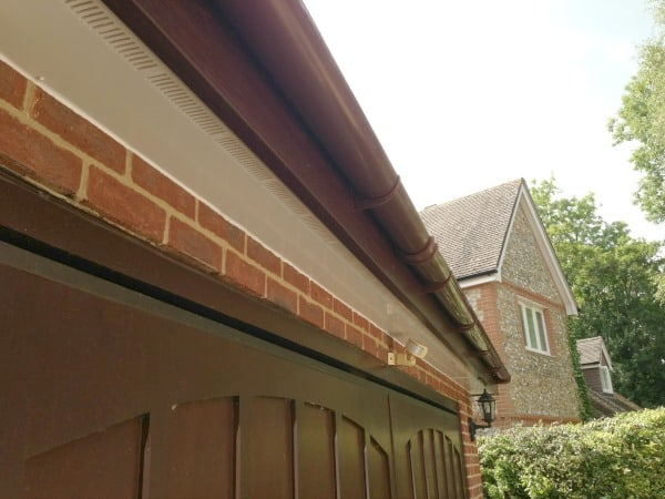 Rosewood coloured uPVC fascia board white vented uPVC soffit board and brown half round deepflow uPVC guttering