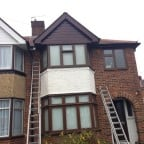 Rosewood colour uPVC fascias, soffits and cladding with black uPVC guttering and downpipes