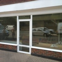 White powder coated aluminium frames which were double glazed with clear laminated glass for security.
