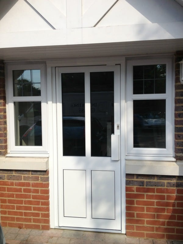 White powder coated commercial aluminium framing with clear toughened double glazed door