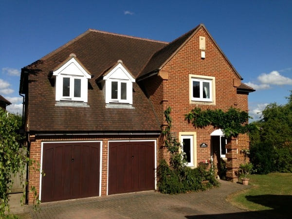 White uPVC fascia and soffits. Black round guttering.