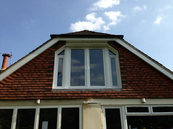 White uPVC fully sculptured Liniar profile A rated double glazed French doors and two tilt and turn windows