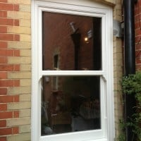 uPVC vertical sliding windows with decorative horns