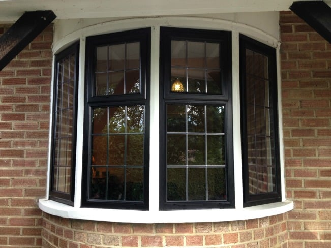 Black out / White in thermally broken powder coated aluminium window inserts installed within the existing timber sub-frames.