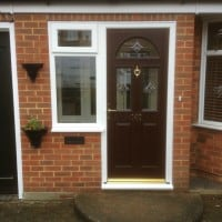 Darkwood out/white in composite door with white uPVC side window
