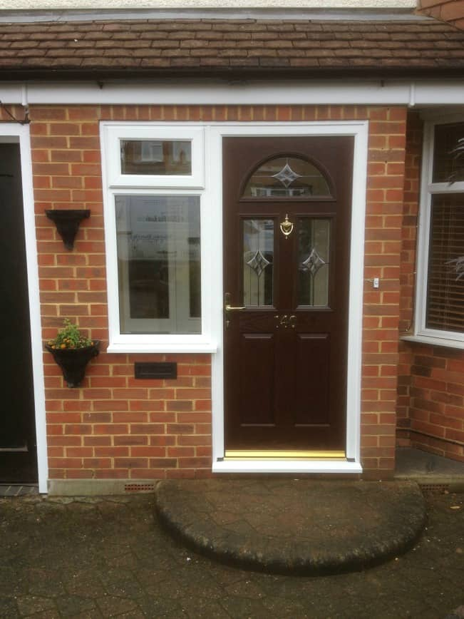 Darkwood out/white in composite door with White PVCu side window.