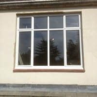 White powder-coated aluminium windows with clear toughened glass