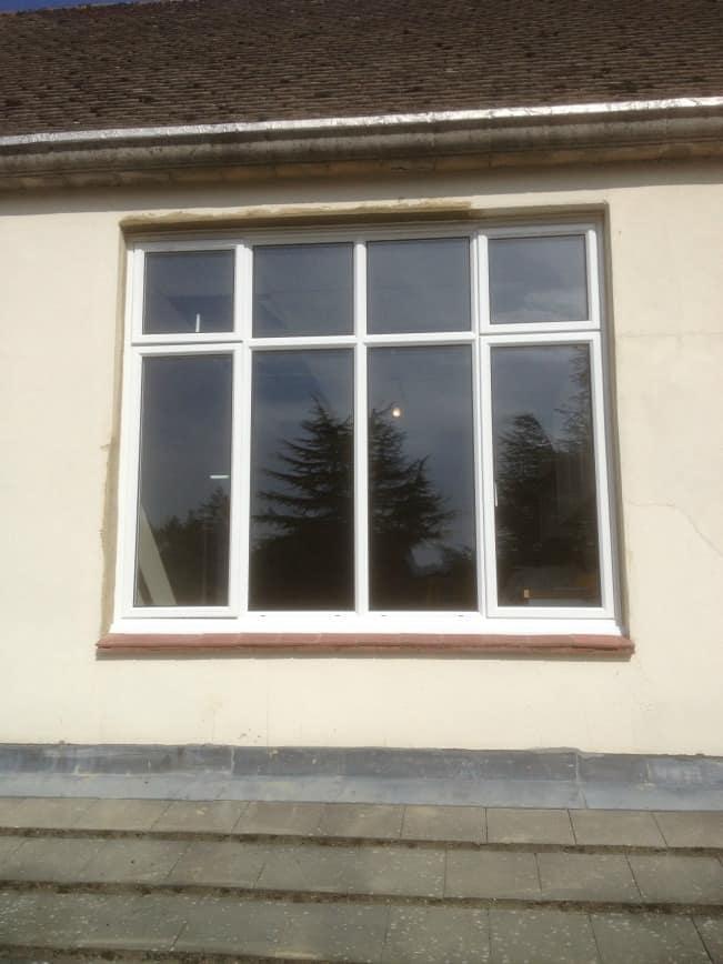 White powder-coated aluminium windows with clear toughened glass