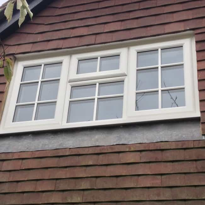 White uPVC Liniar profile with surface mounted Georgian Bars.