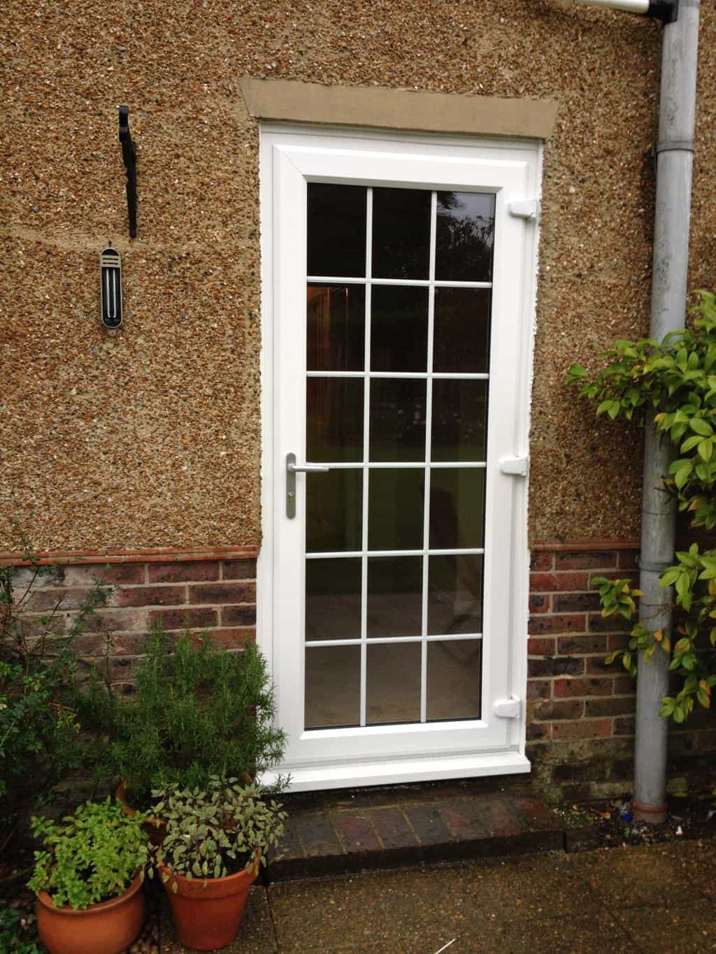 Double glazing reigate new woodgrain upvc front door for Upvc glass front doors