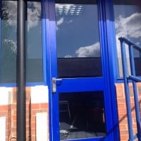 Blue aluminium fire door in Leatherhead